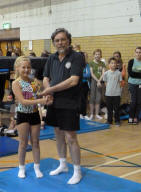 Maddie getting Junior Jumper award from Dave