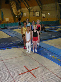 Young members with new trampoline bed