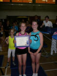 Victoria Webb geting her certificate from 'Big Sis'