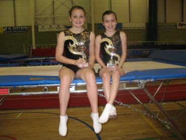 Hannah & Kensie with their trophies
